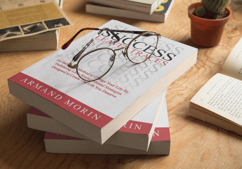 three-books-mockup-lying-on-top-of-each-other-and-round-glasses-a17407
